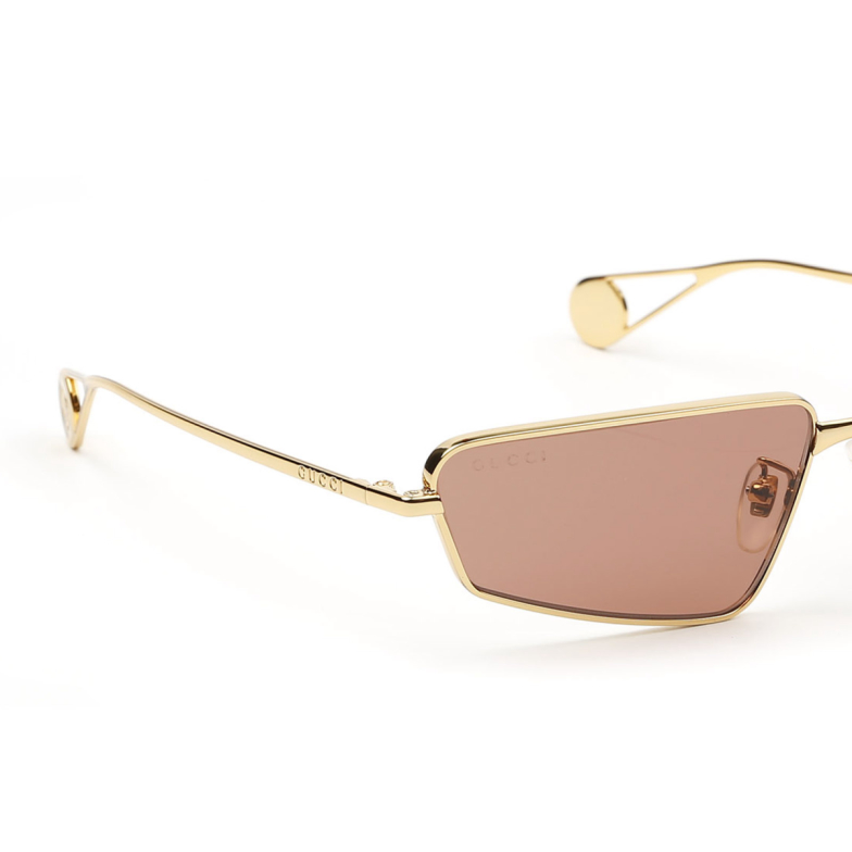 Gucci® Rectangle Sunglasses: GG0537S color Gold 002.