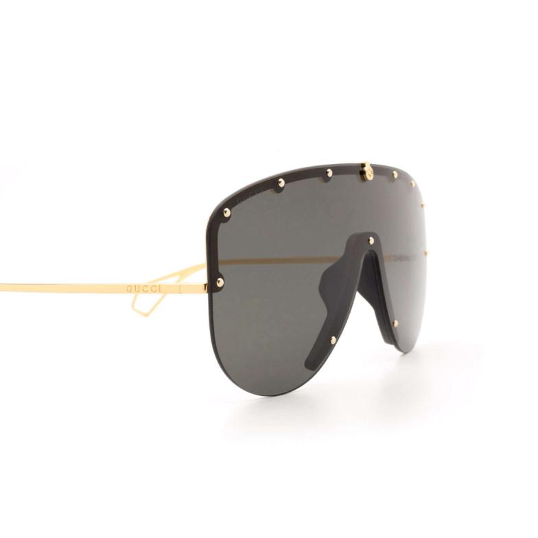 Gucci® Aviator Sunglasses: GG0667S color Gold 001.