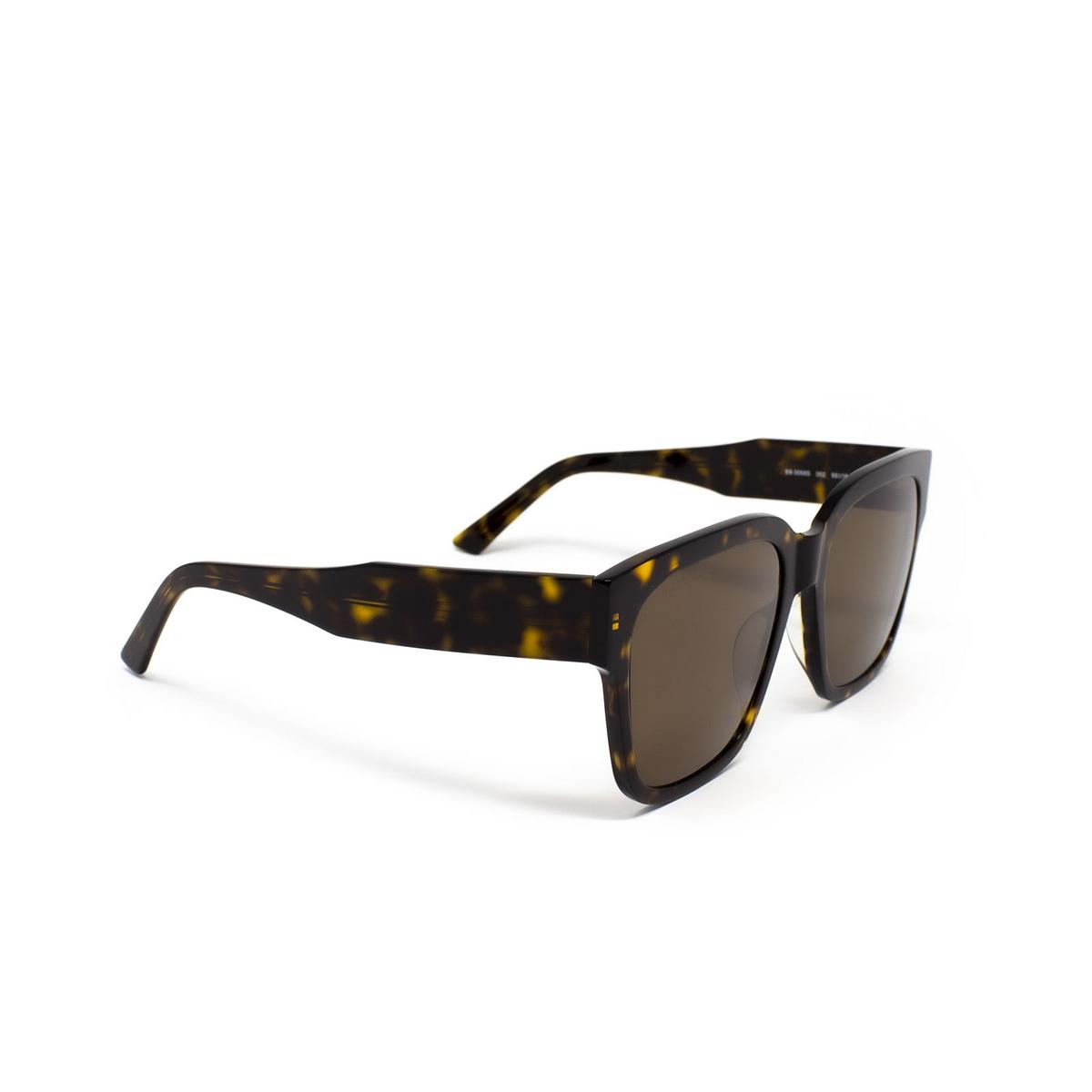 Balenciaga® Square Sunglasses: BB0056S color Havana 002 - three-quarters view.
