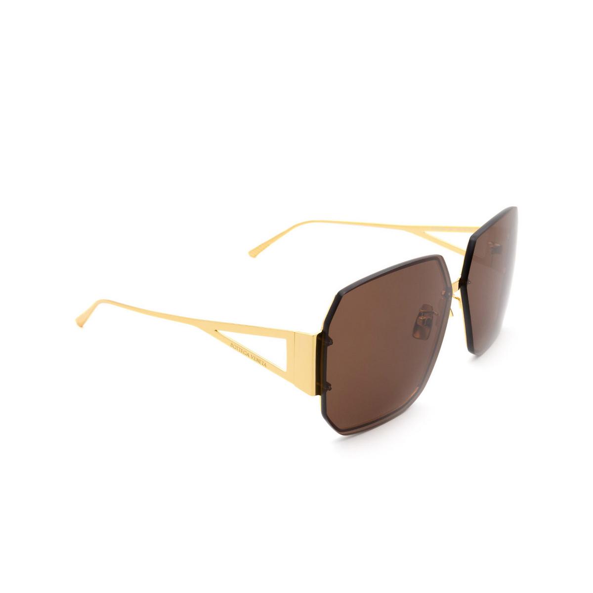 Bottega Veneta® Square Sunglasses: BV1085SA color Gold 002 - three-quarters view.