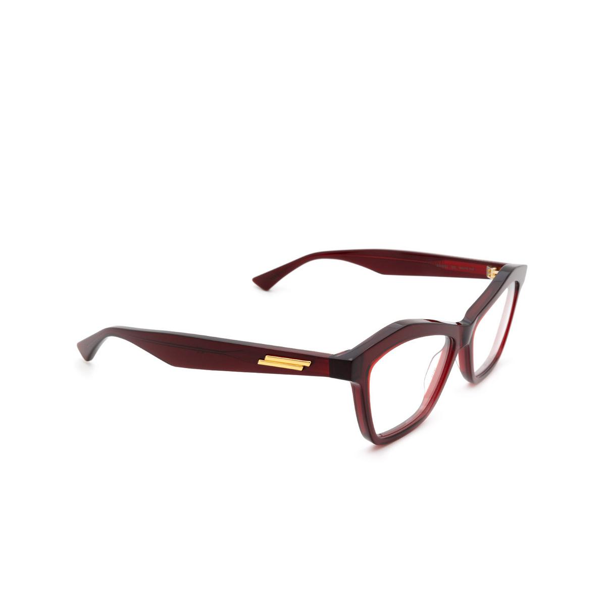 Bottega Veneta® Cat-eye Eyeglasses: BV1096O color Red 003 - three-quarters view.
