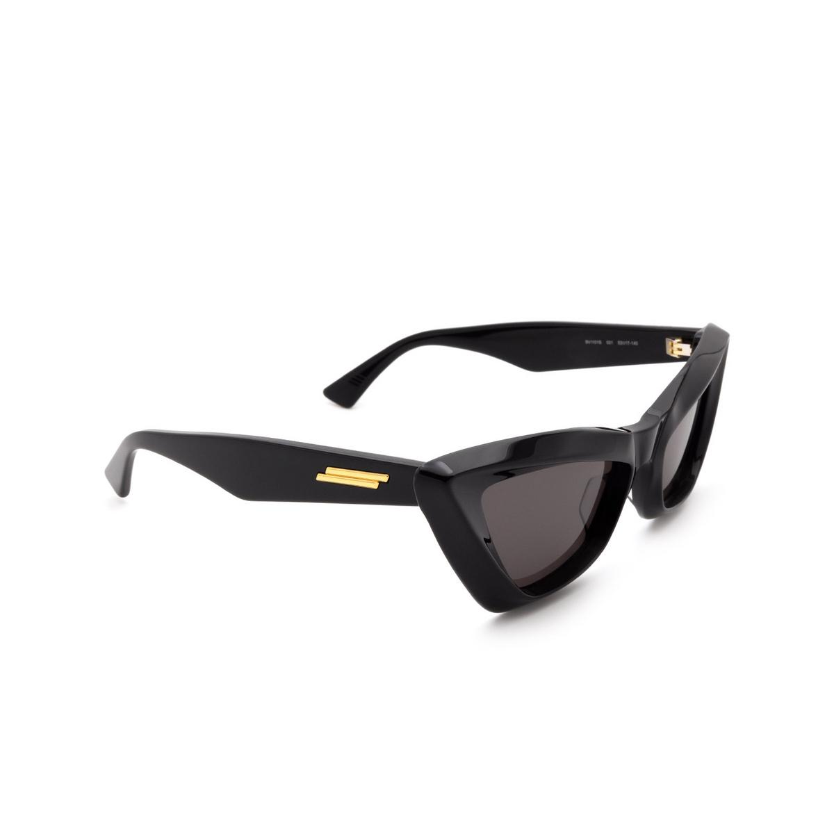 Bottega Veneta® Cat-eye Sunglasses: BV1101S color Black 001 - three-quarters view.