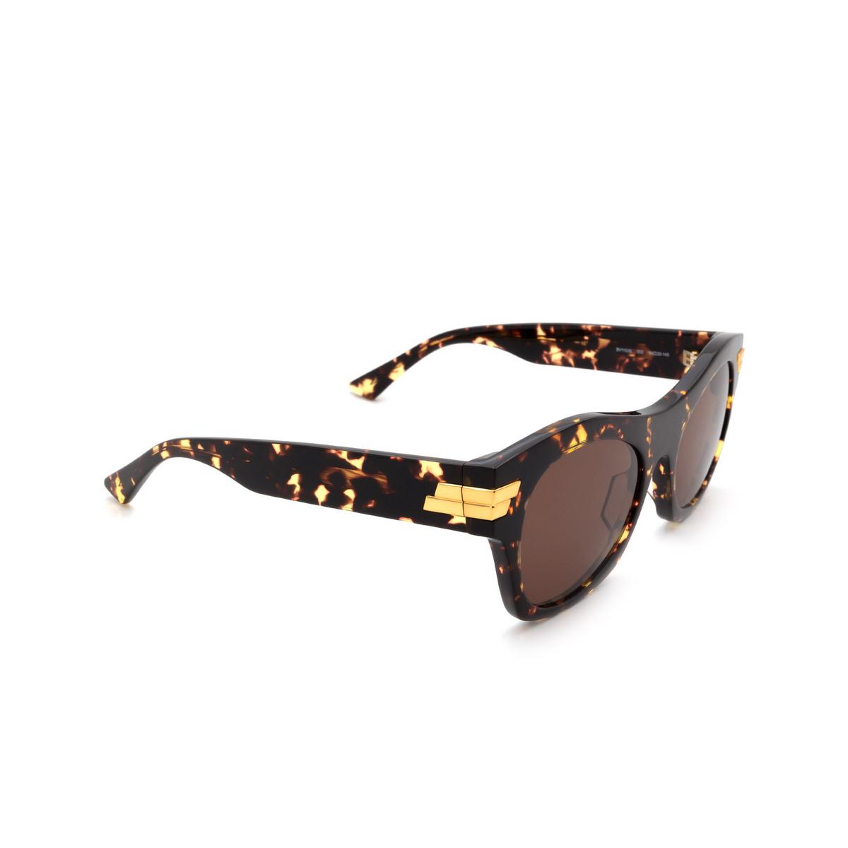 Bottega Veneta® Square Sunglasses: BV1103S color Havana 002 - three-quarters view.