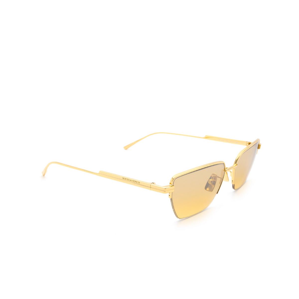 Bottega Veneta® Rectangle Sunglasses: BV1107S color Gold 002 - three-quarters view.