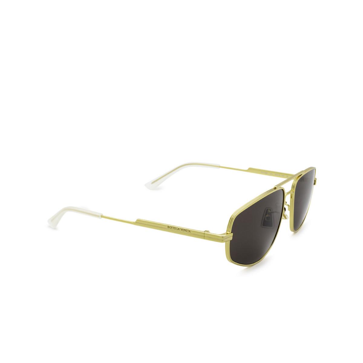 Bottega Veneta® Aviator Sunglasses: BV1125S color Gold 002 - three-quarters view.
