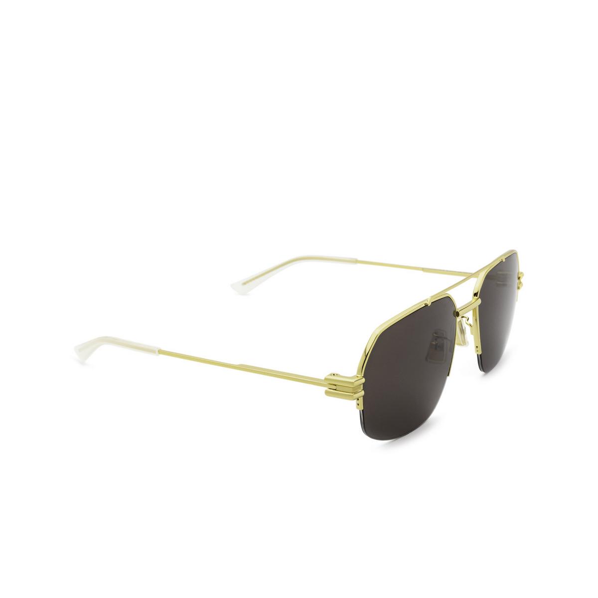 Bottega Veneta® Irregular Sunglasses: BV1127S color Gold 002 - three-quarters view.