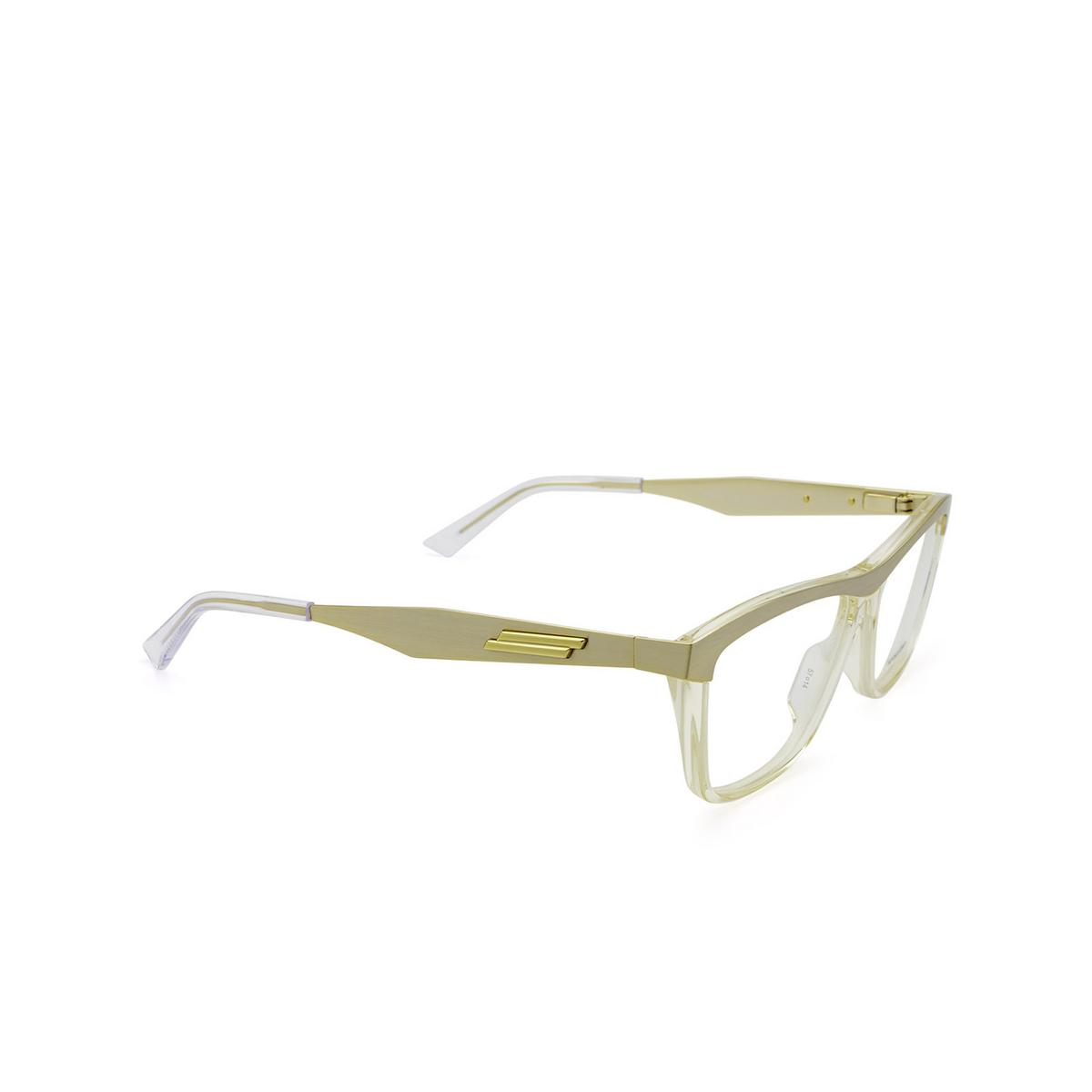 Bottega Veneta® Rectangle Eyeglasses: BV1133O color Gold & Transparent Beige 002 - three-quarters view.