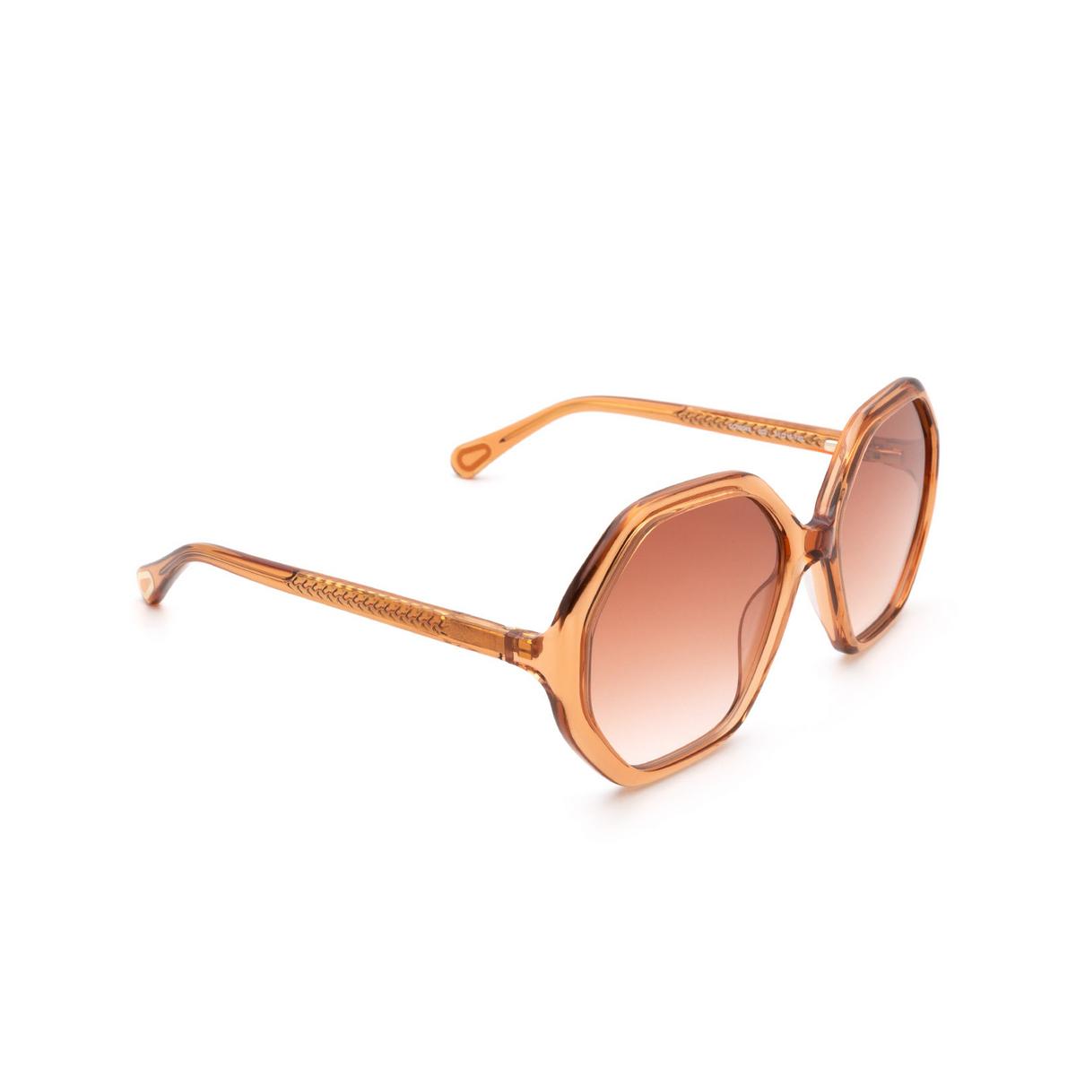 Chloé® Irregular Sunglasses: CC0004S color Orange 002 - three-quarters view.