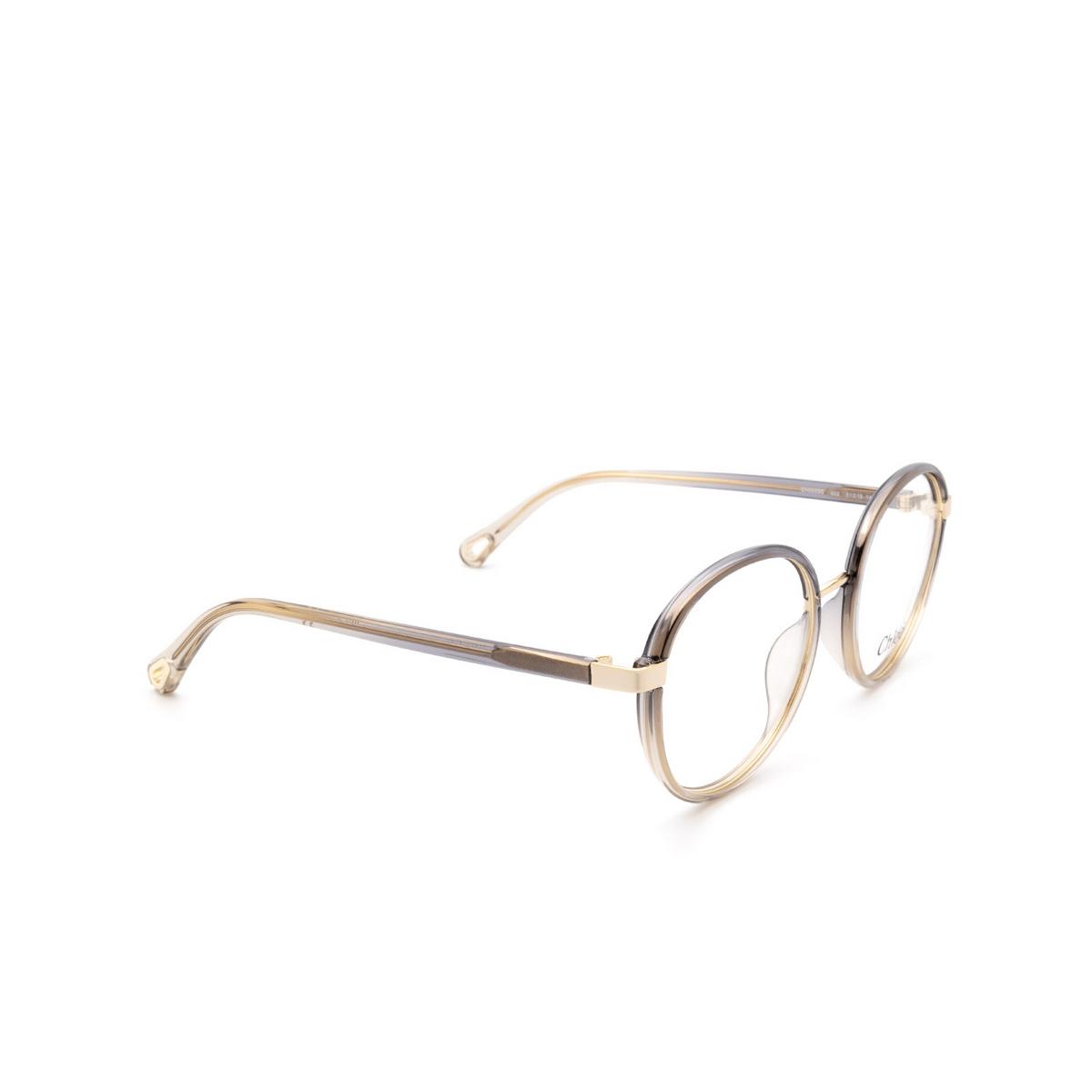 Chloé® Round Eyeglasses: CH0033O color Grey 002 - three-quarters view.