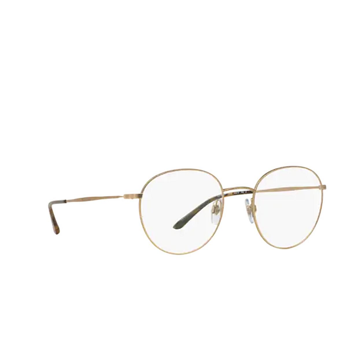 Giorgio Armani® Round Eyeglasses: AR5057 color Matte Pale Gold 3002 - three-quarters view.
