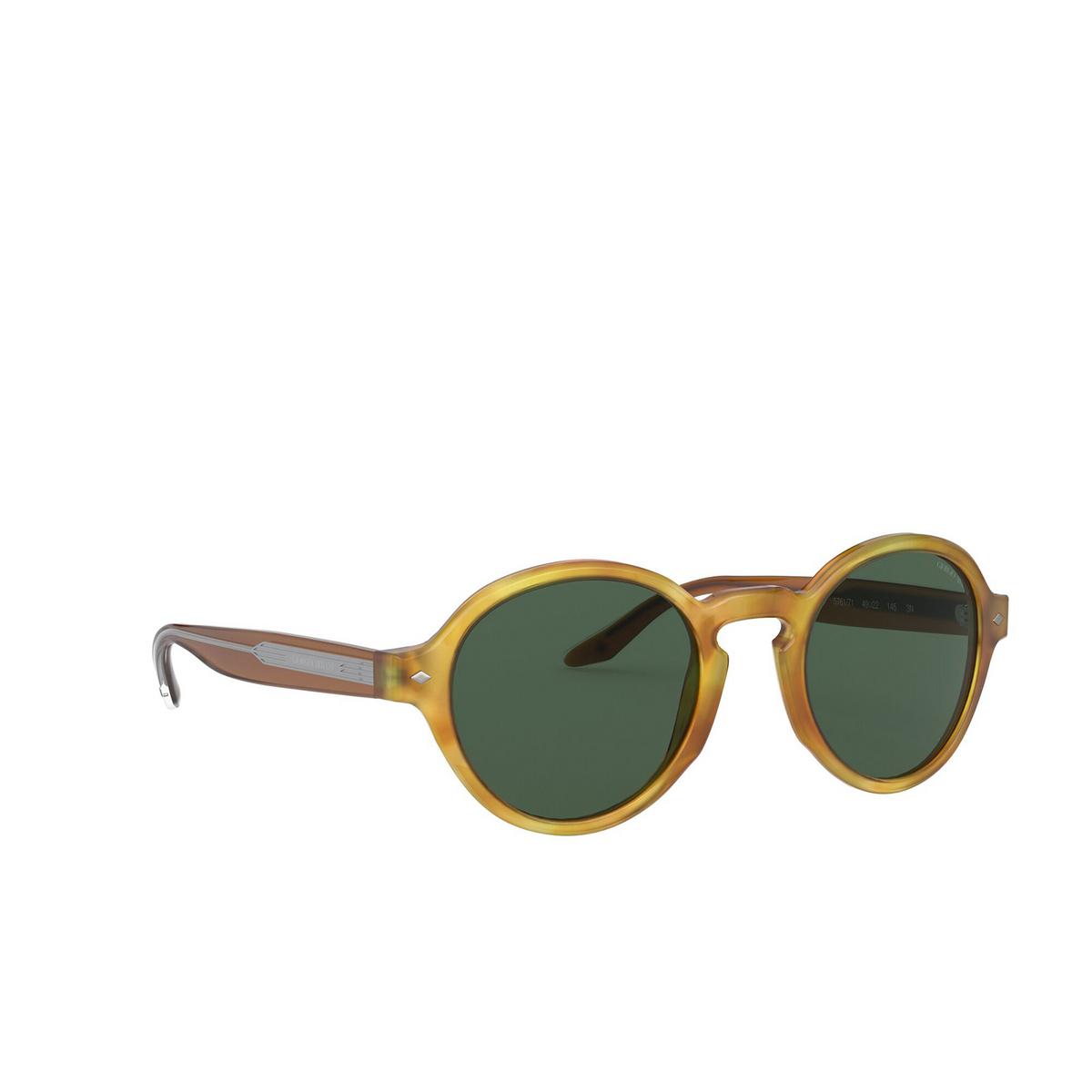 Giorgio Armani® Round Sunglasses: AR8130 color Yellow Havana 576171 - three-quarters view.