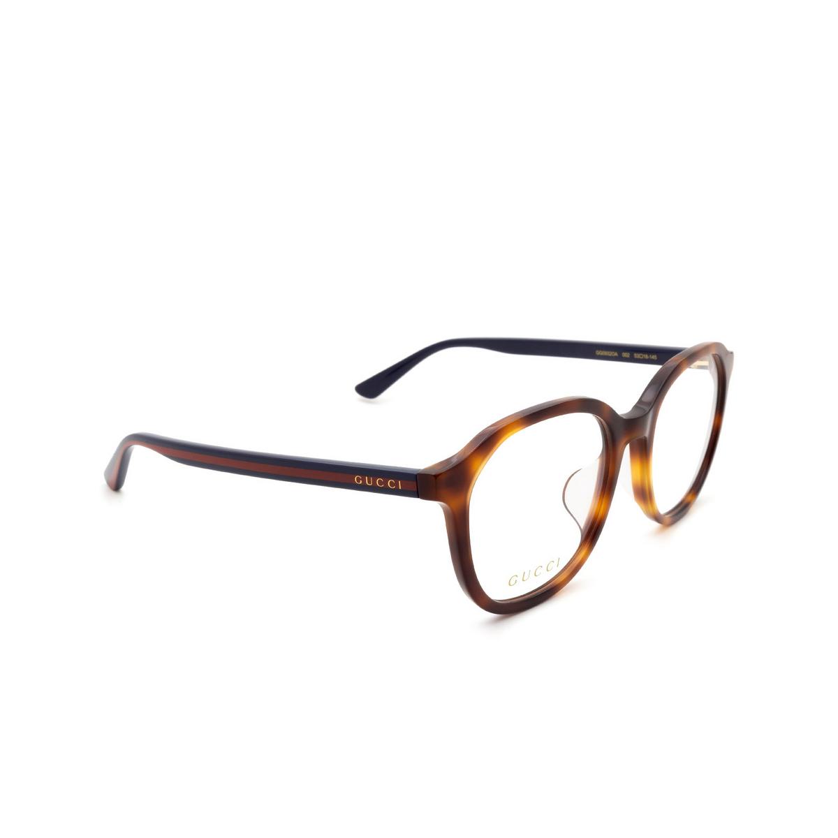Gucci® Round Eyeglasses: GG0932OA color Havana 002 - three-quarters view.