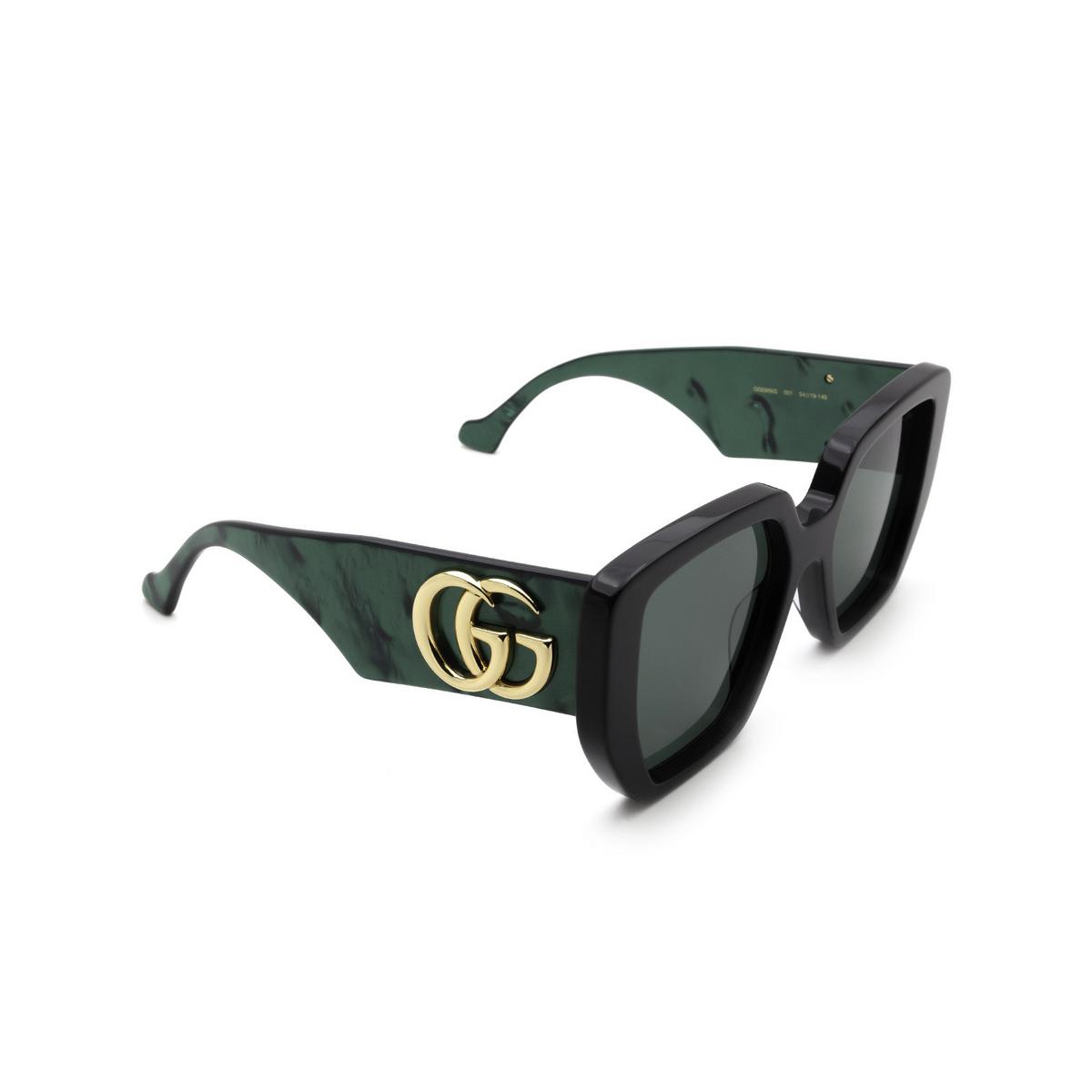 Gucci® Irregular Sunglasses: GG0956S color Black 001 - three-quarters view.