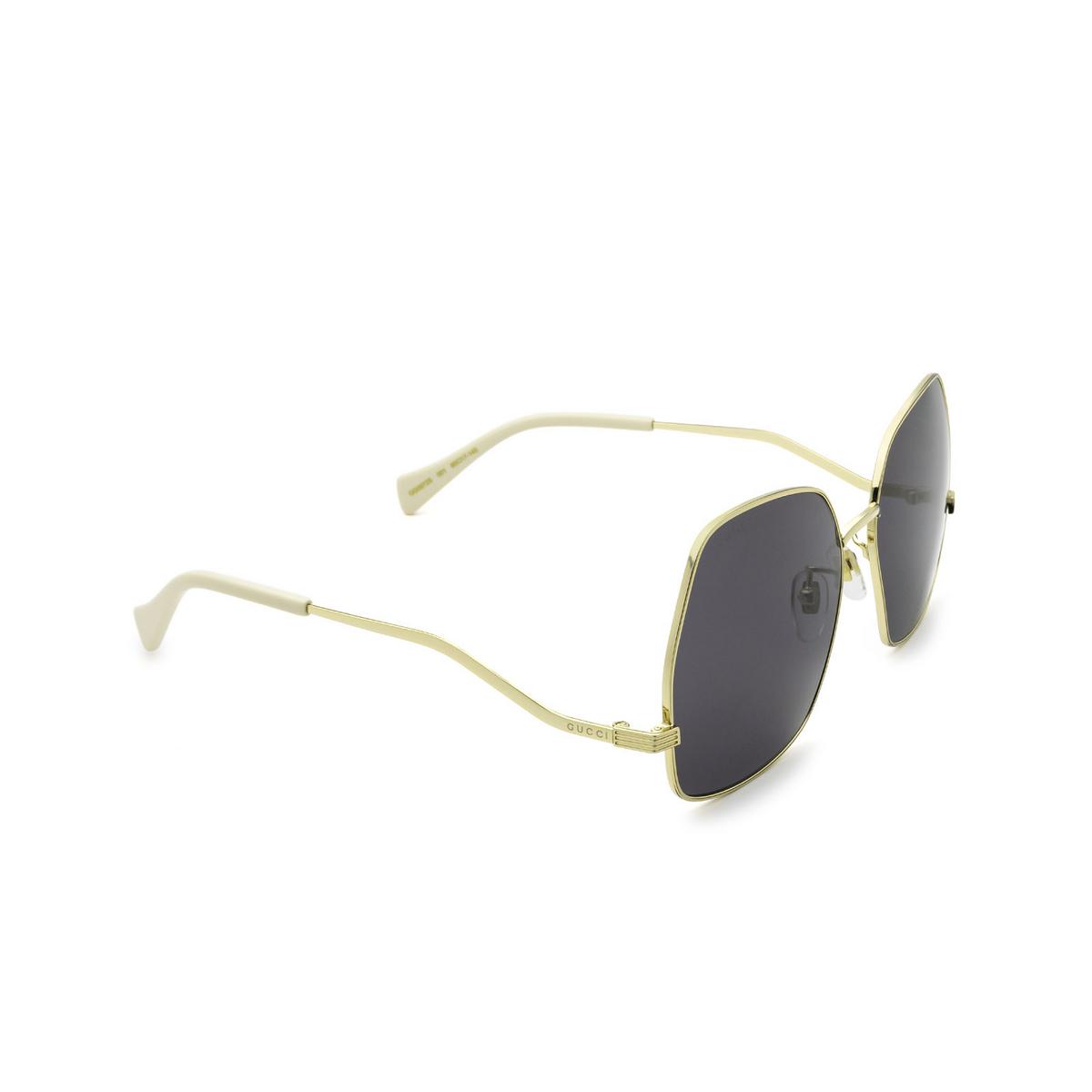 Gucci® Irregular Sunglasses: GG0972S color Gold 001 - three-quarters view.