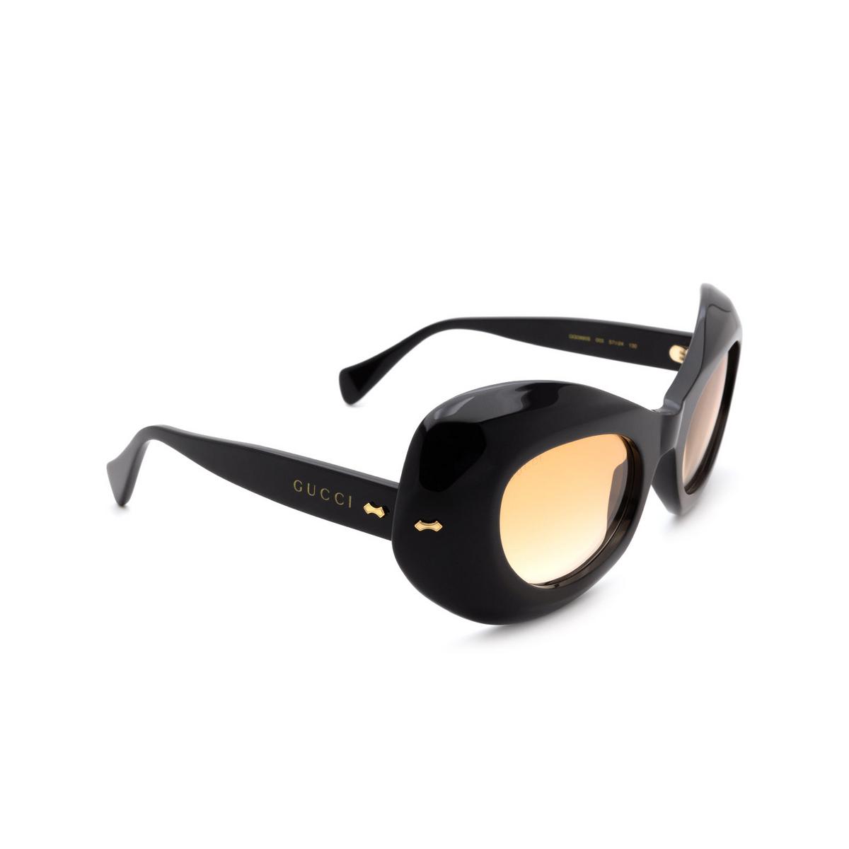 Gucci® Oval Sunglasses: GG0990S color Black 003 - three-quarters view.