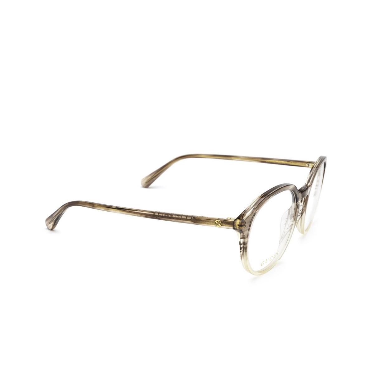 Gucci® Round Eyeglasses: GG1004O color Grey Gradient 003 - three-quarters view.