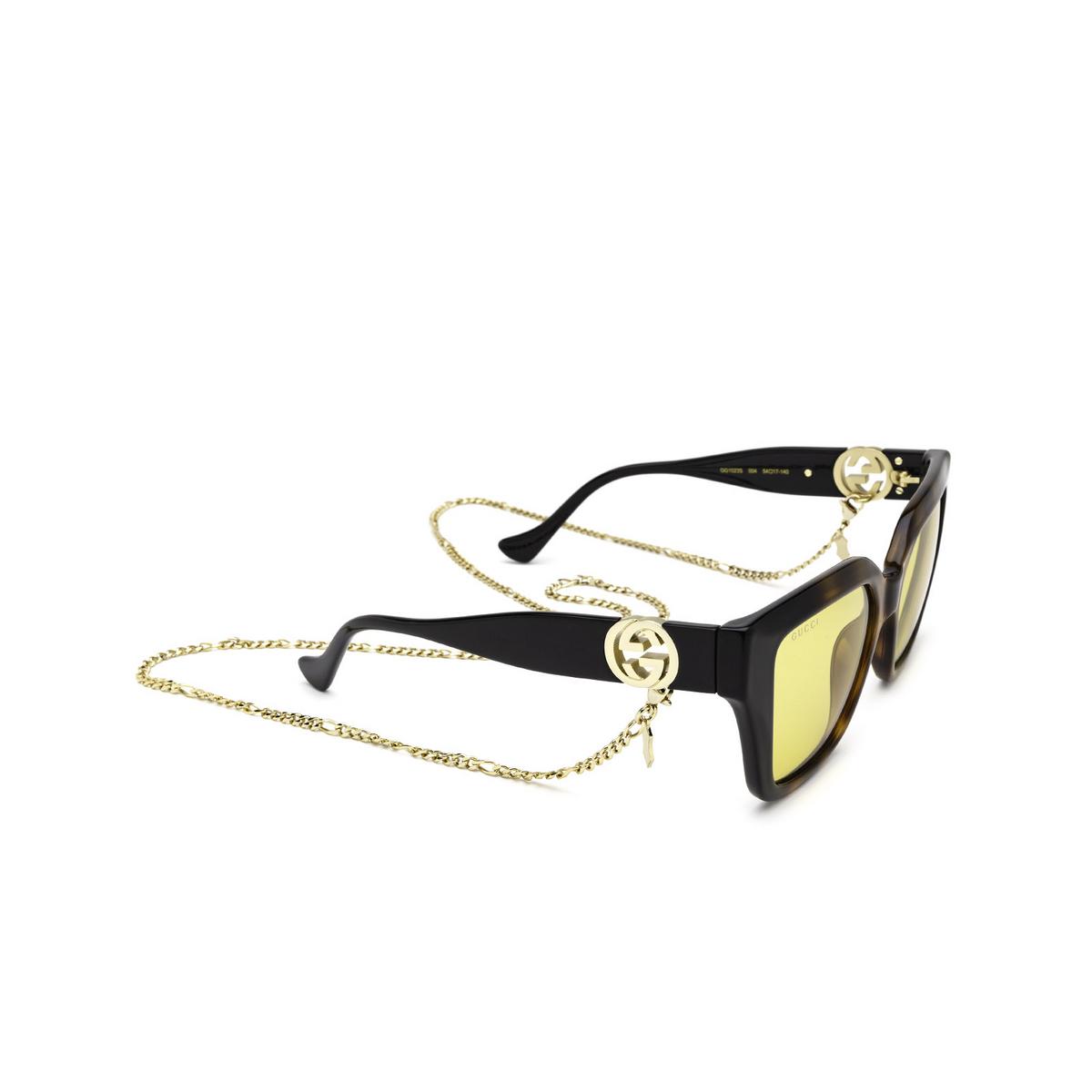 Gucci® Butterfly Sunglasses: GG1023S color Havana & Black 004 - three-quarters view.