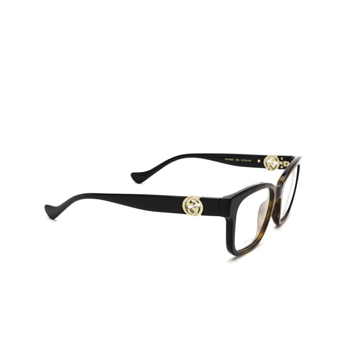 Gucci® Square Eyeglasses: GG1025O color Black & Havana 002 - three-quarters view.