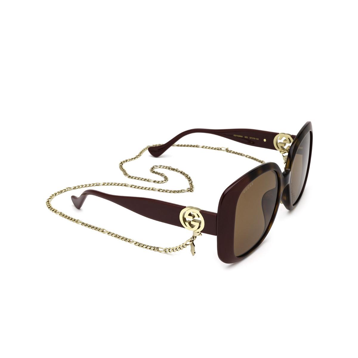 Gucci® Square Sunglasses: GG1029SA color Havana & Burgundy 003 - three-quarters view.