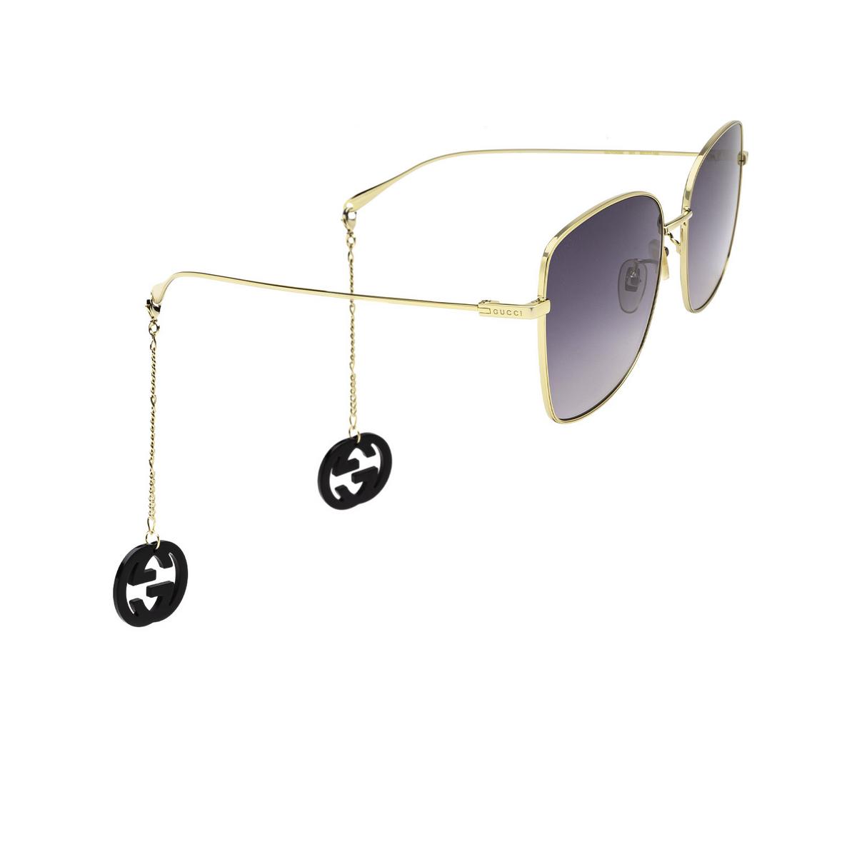 Gucci® Square Sunglasses: GG1030SK color Gold 001 - three-quarters view.