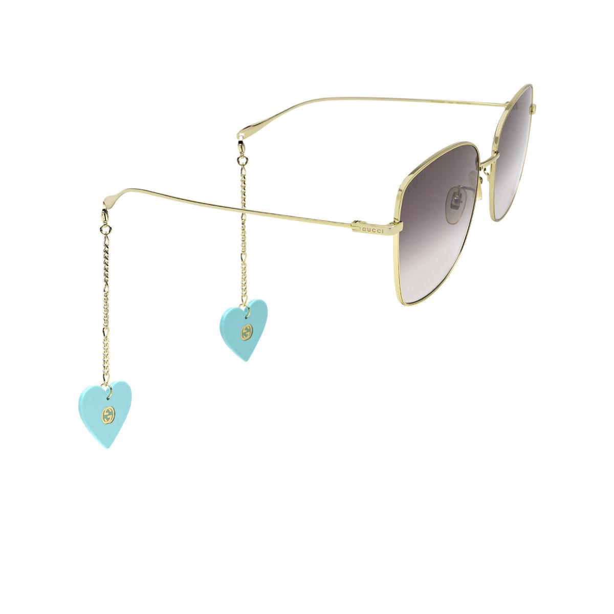 Gucci® Square Sunglasses: GG1030SK color Gold 003 - three-quarters view.