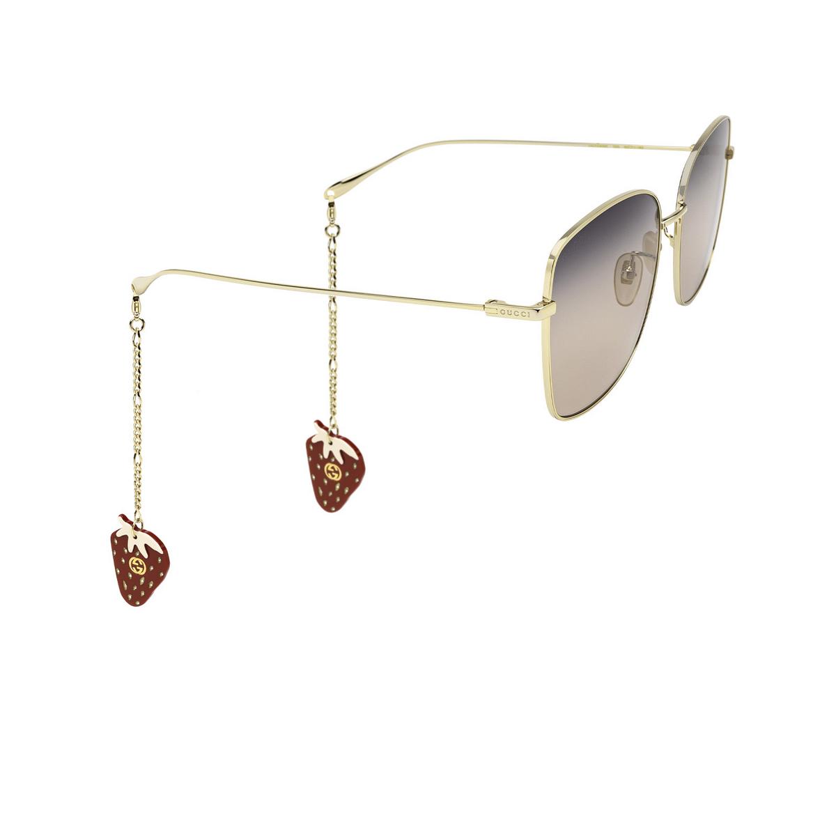 Gucci® Square Sunglasses: GG1030SK color Gold 005 - three-quarters view.