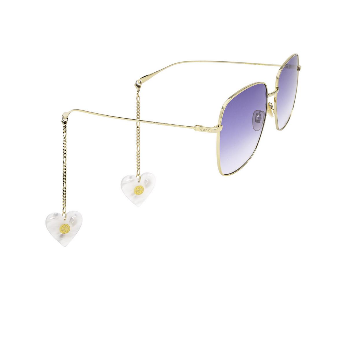 Gucci® Square Sunglasses: GG1031S color Gold 004 - three-quarters view.