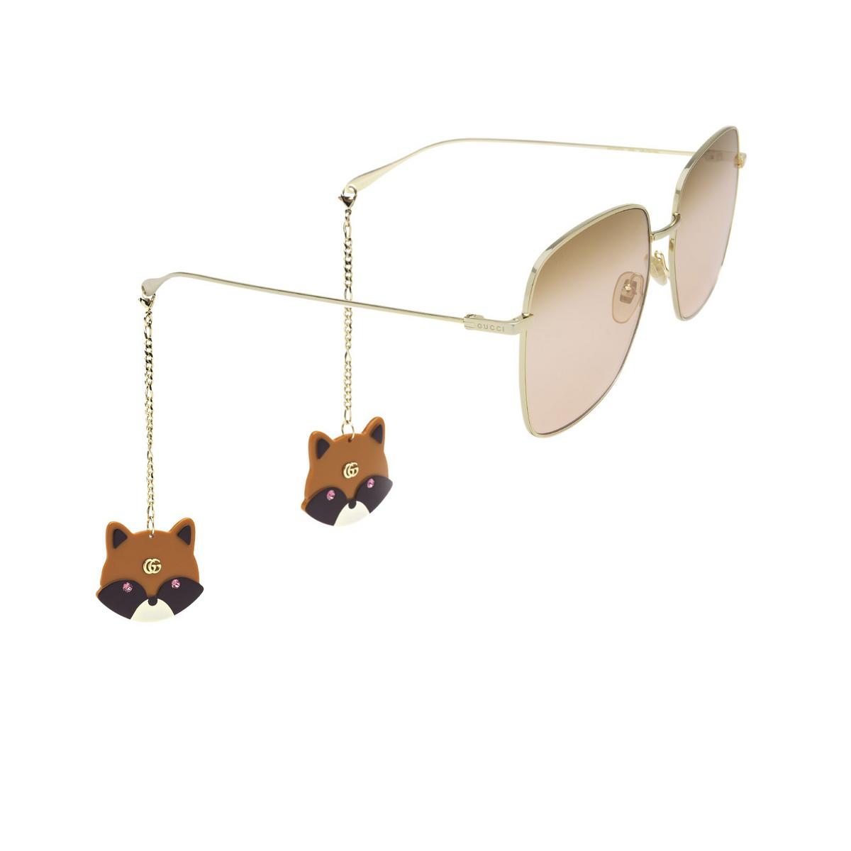 Gucci® Square Sunglasses: GG1031S color Gold 005 - three-quarters view.