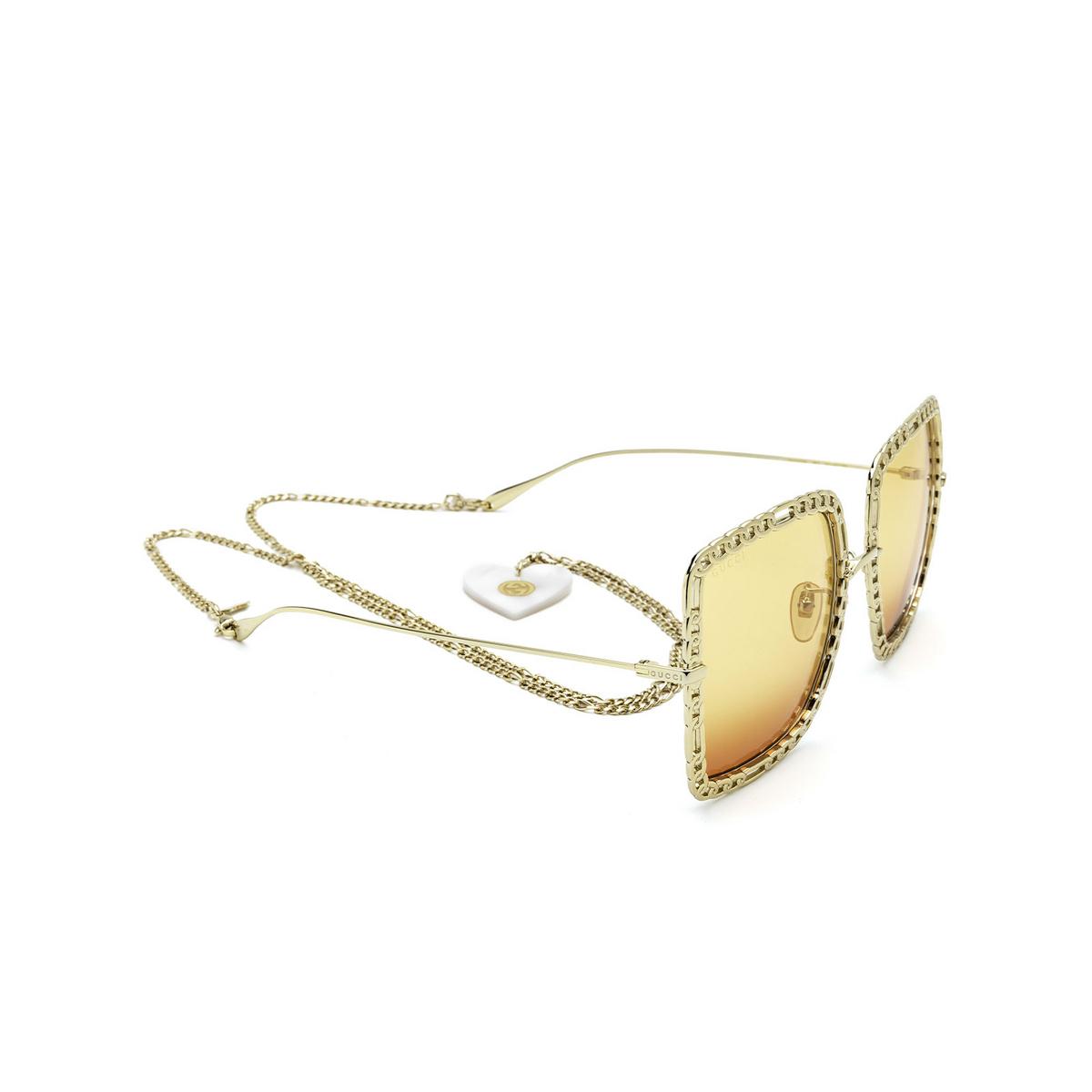 Gucci® Square Sunglasses: GG1033S color Gold 001 - three-quarters view.