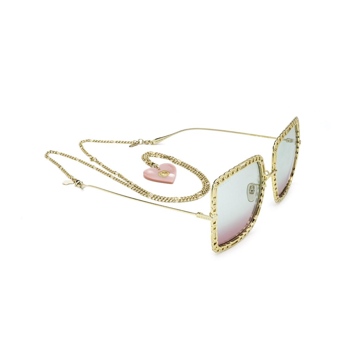 Gucci® Square Sunglasses: GG1033S color Gold 003 - three-quarters view.