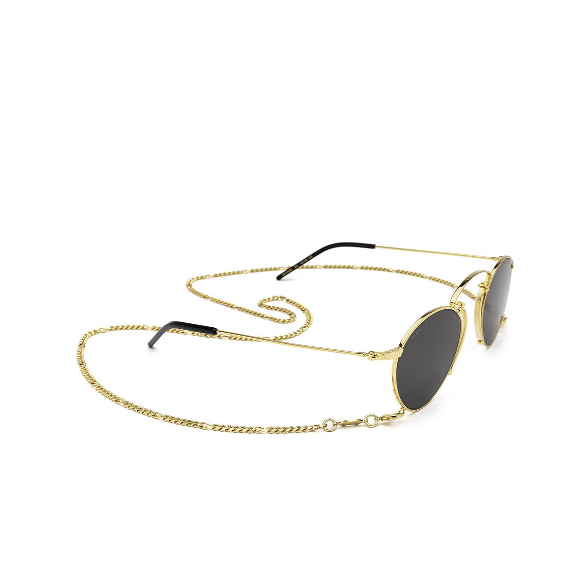 Gucci® Round Sunglasses: GG1034S color Gold 002 - three-quarters view.