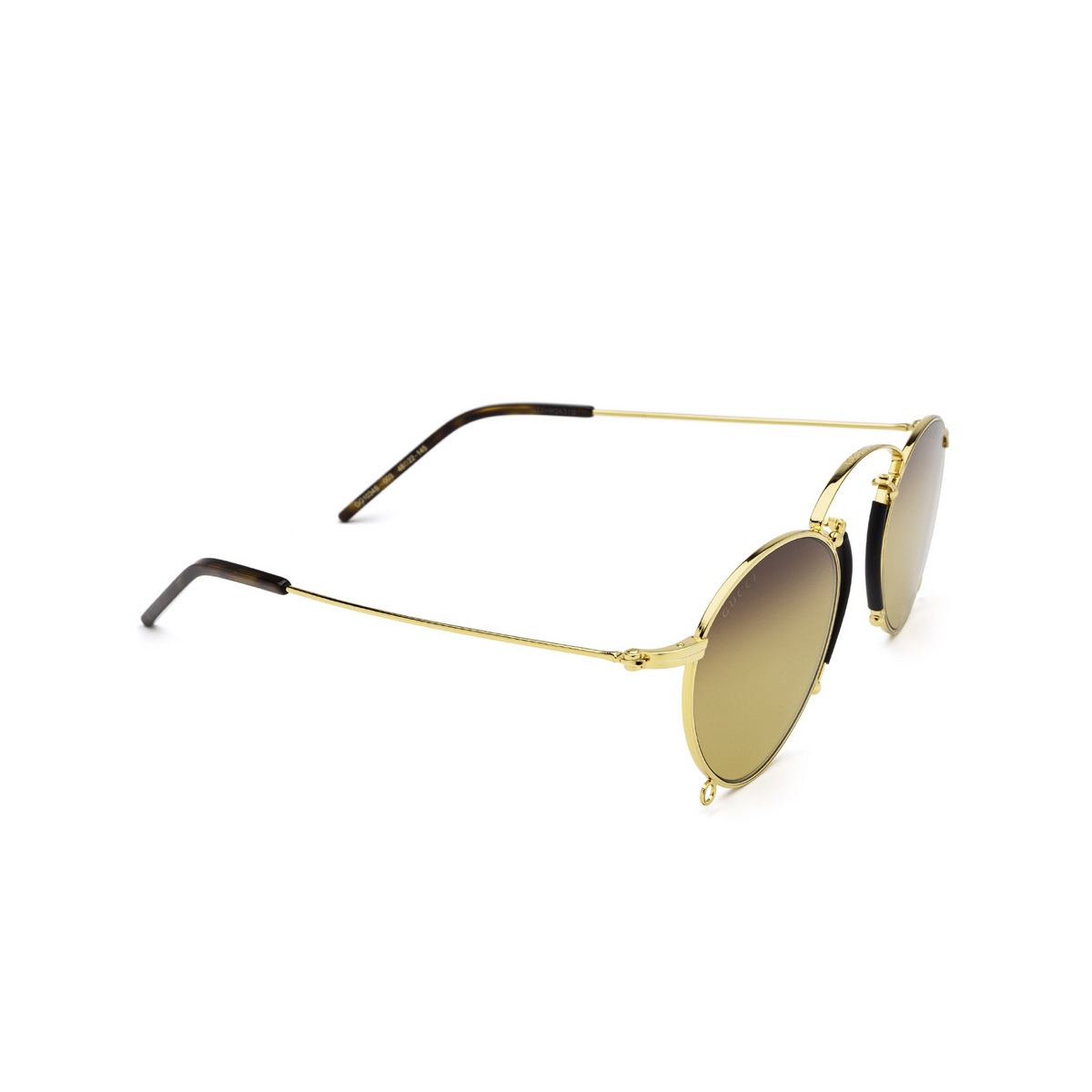 Gucci® Round Sunglasses: GG1034S color Gold 003 - three-quarters view.