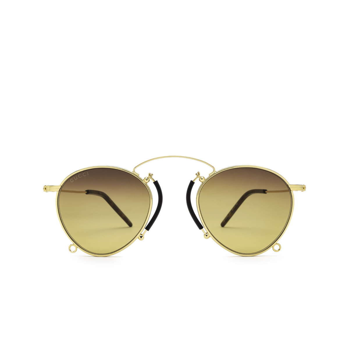 Gucci® Round Sunglasses: GG1034S color Gold 003 - front view.