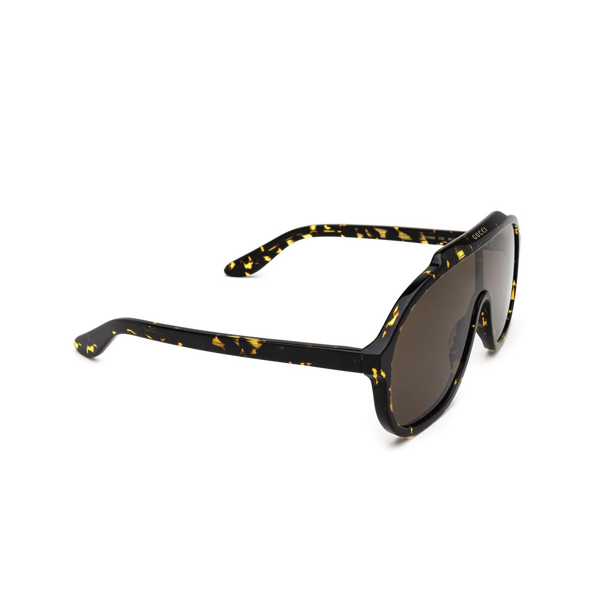 Gucci® Mask Sunglasses: GG1038S color Havana 002 - three-quarters view.