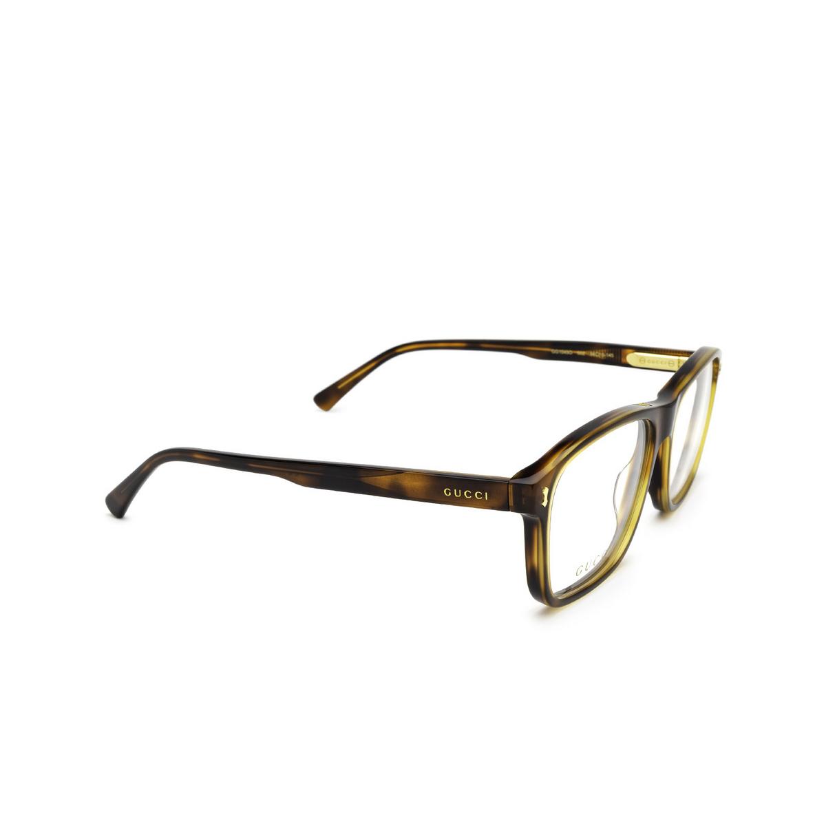 Gucci® Rectangle Eyeglasses: GG1045O color Havana 002 - three-quarters view.
