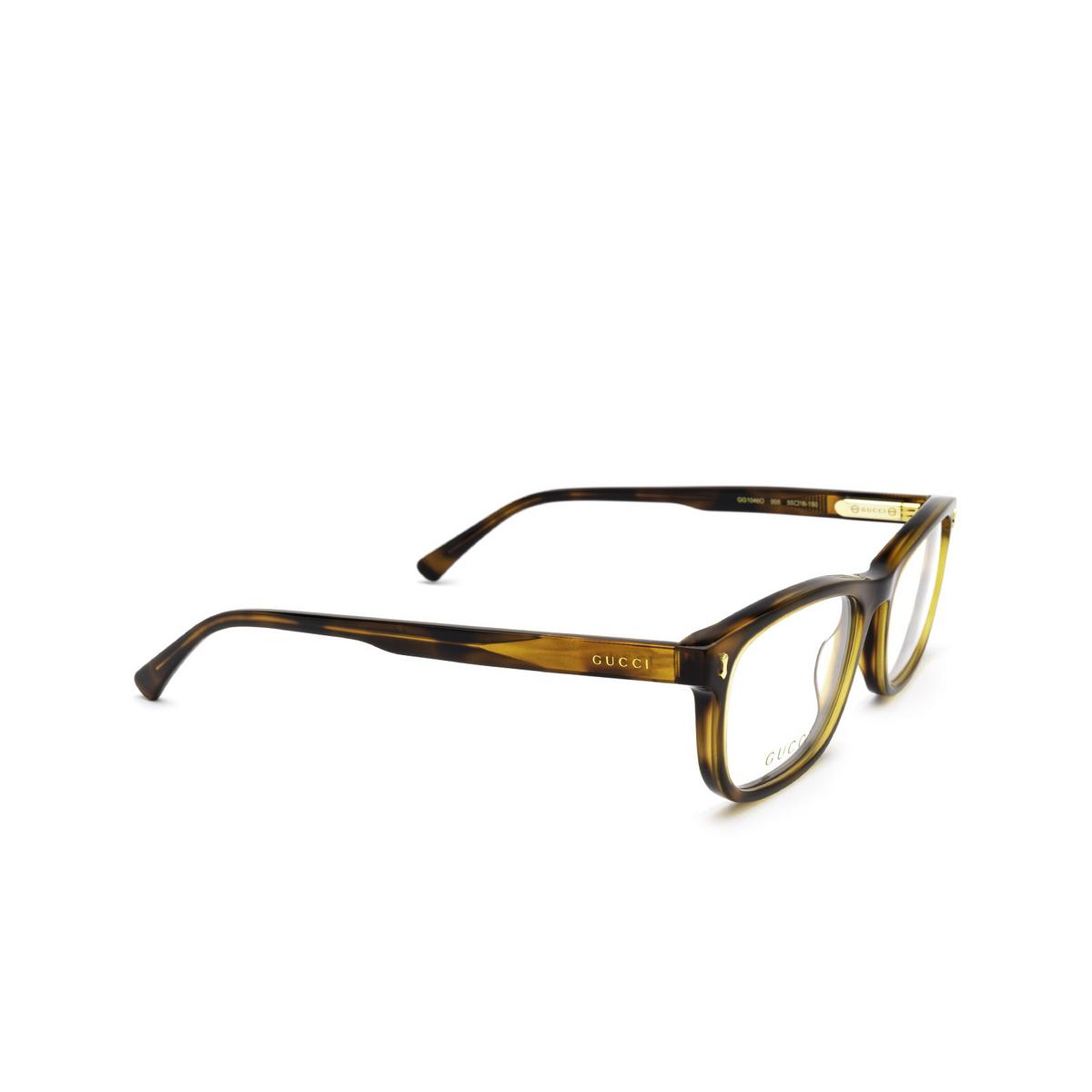 Gucci® Rectangle Eyeglasses: GG1046O color Havana 005 - three-quarters view.