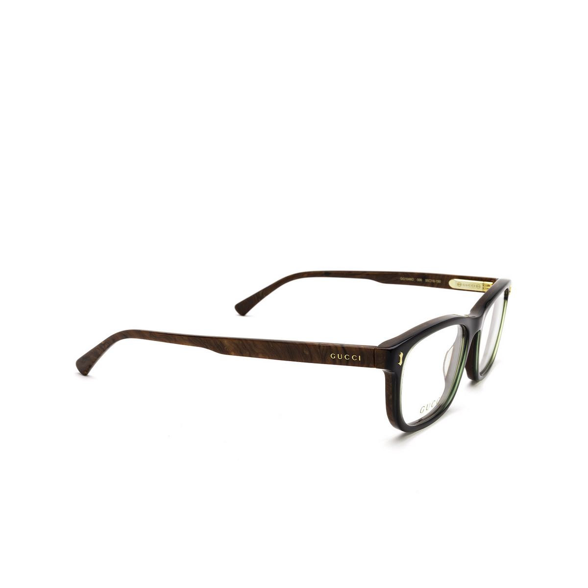 Gucci® Rectangle Eyeglasses: GG1046O color Brown 006 - three-quarters view.