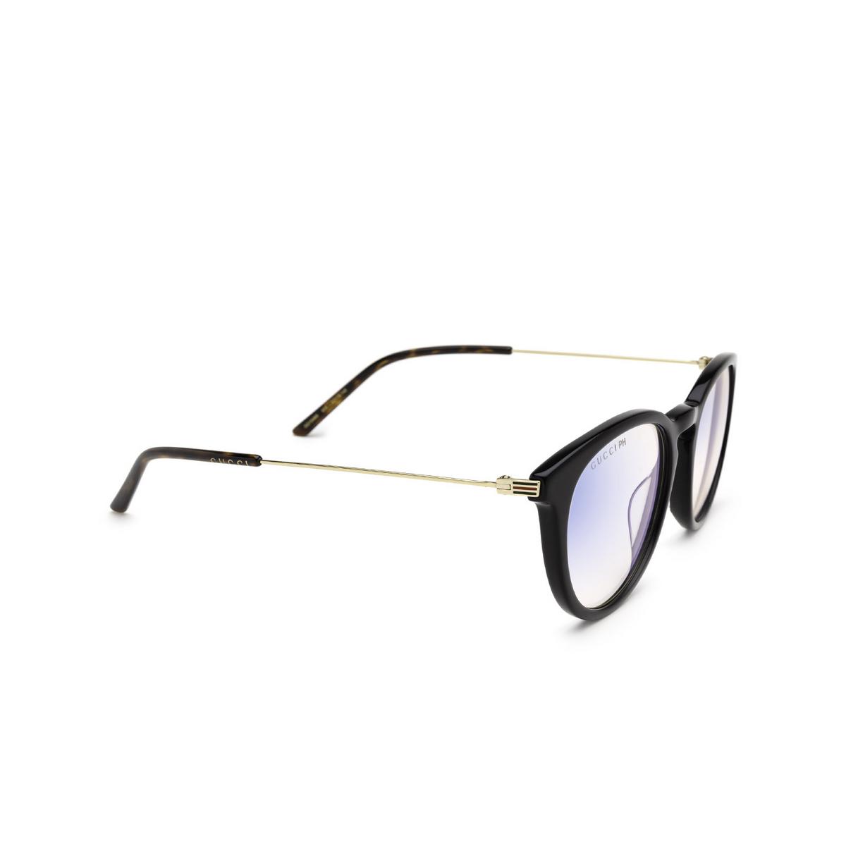 Gucci® Round Sunglasses: GG1048S color Black 005 - three-quarters view.