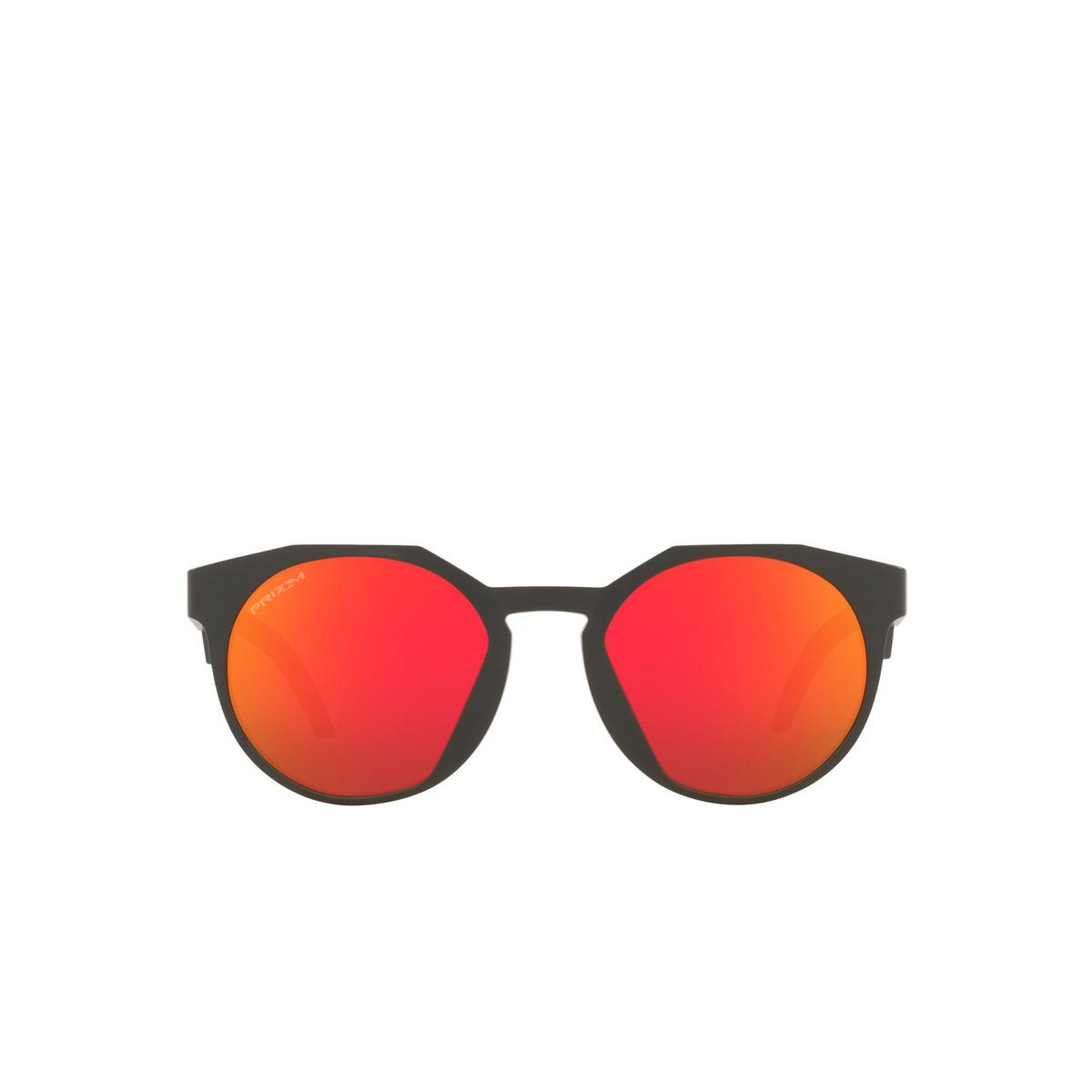 Oakley® Round Sunglasses: Hstn OO9464 color Matte Carbon 946403 - front view.