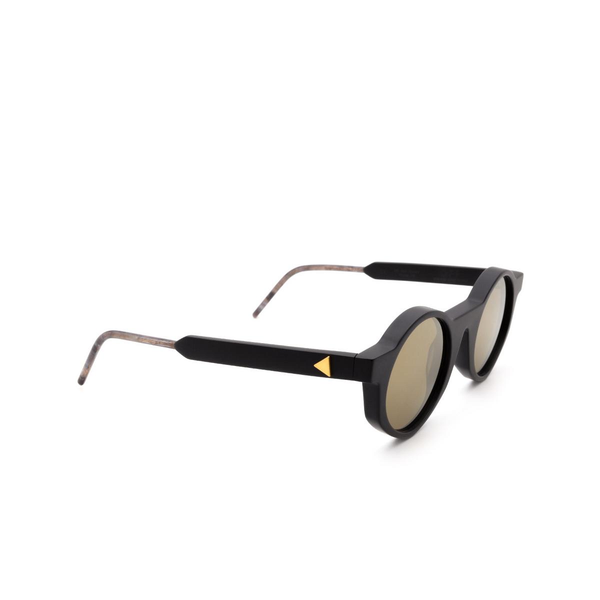Soya® Round Sunglasses: Off color Matte Black Bkm-g - three-quarters view.