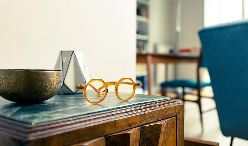 Lesca Yoga eyeglasses on an ancient-cabinet
