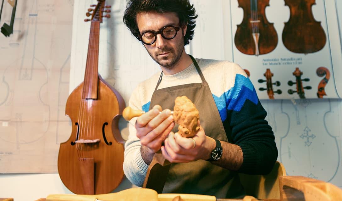 Gianfranco crafting a viola da gamba