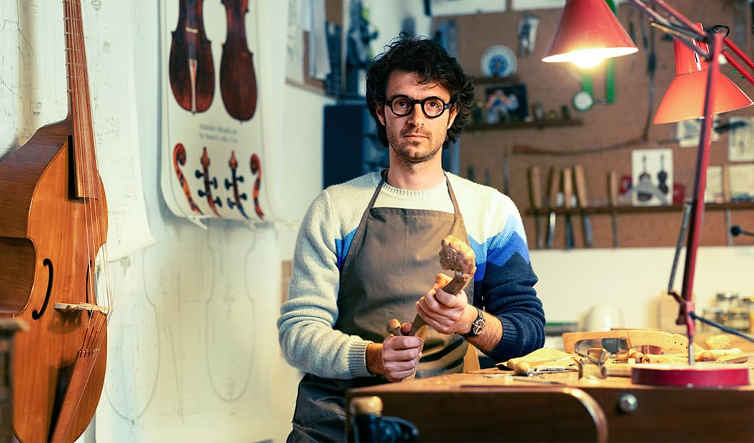 Gianfranco in his home studio wearing a pair of handmade glasses by Lesca