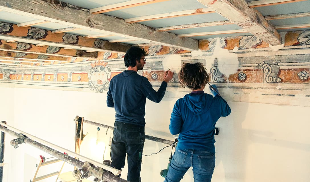 The two restorers working on the frescoed ceiling