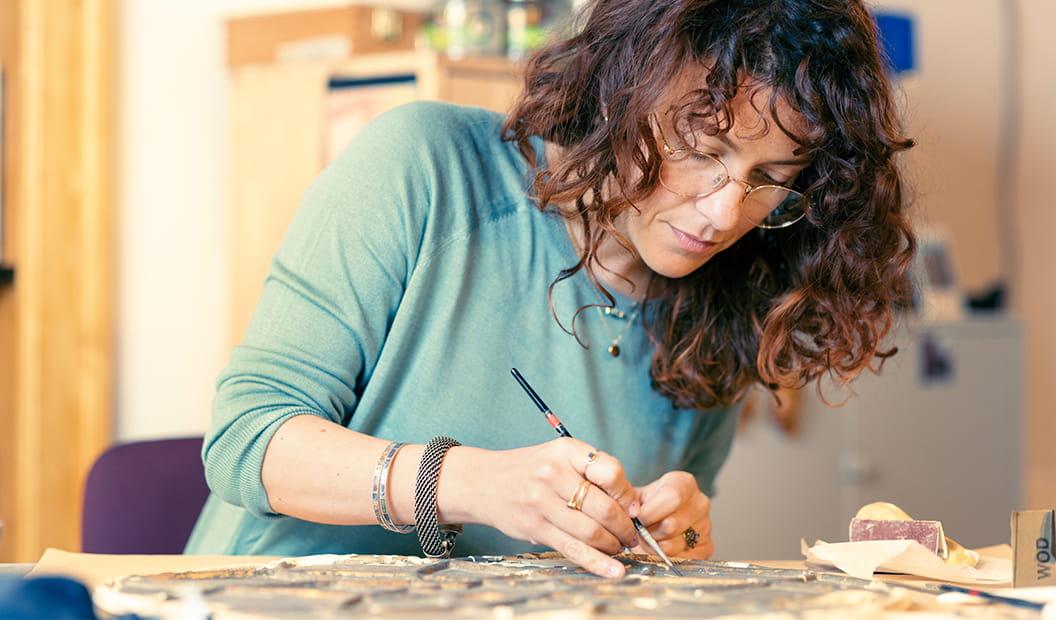 Ginevra, restorer, at work in her home studio