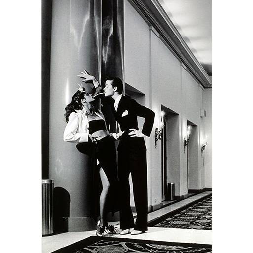 """""""Woman into Man, lighting a cigarette"""" by Helmut Newton for Vogue, 1979."""
