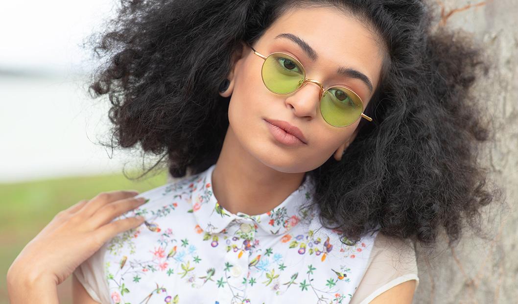 Curly woman wearing Eyepetizer sunglasses | Mia Burton Magazine