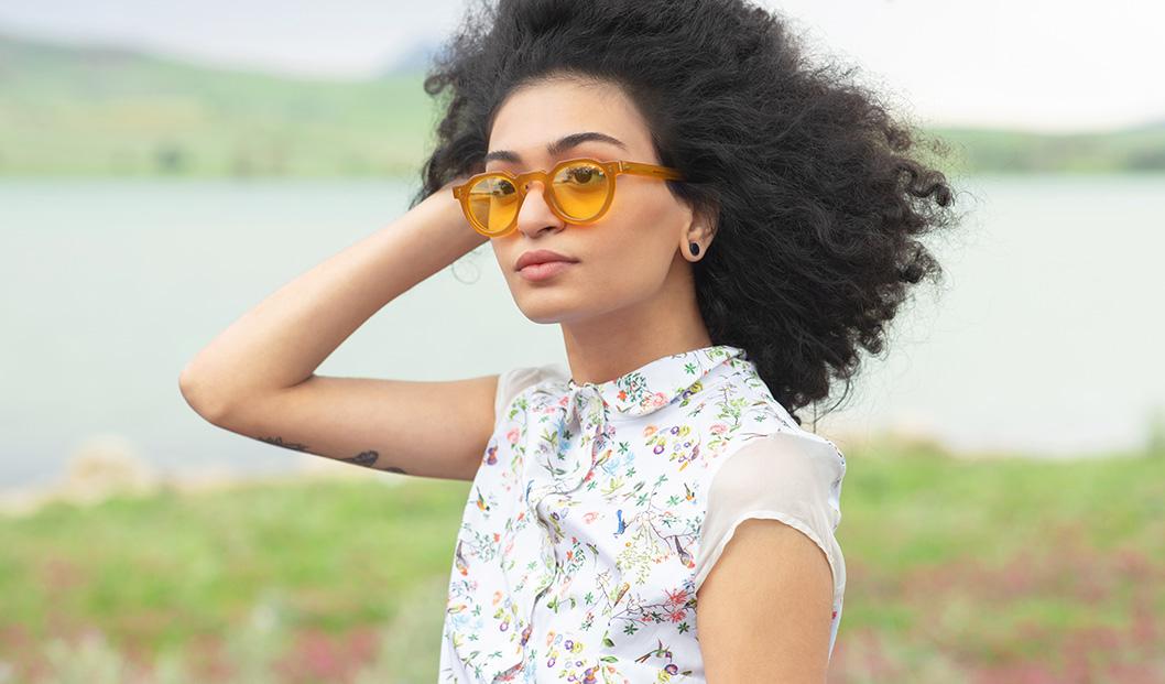 Young woman wearing Lesca sunglasses | Mia Burton Magazine